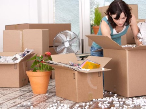 woman-surrounded-by-open-packing-boxes-large